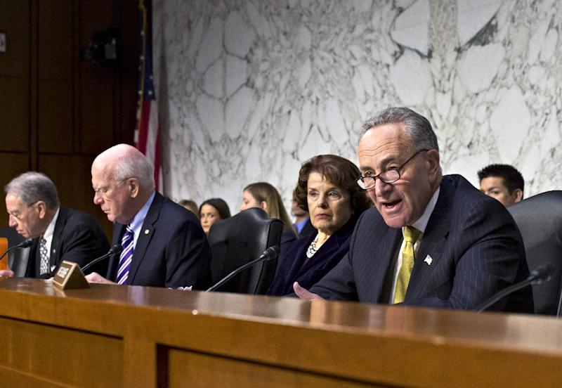 Senate Judiciary Committee member Sen. Charles Schumer, D-N.Y., right, questions a panel of witnesses during the committee's hearing on immigration reform after a bipartisan group of senators agreed last week on legislation that would dramatically remake the U.S. immigration system, Monday, April 22, 2013, on Capitol Hill in Washington. From left are, Sen. Chuck Grassley, R-Iowa, the committee's ranking member; Committee Chairman Sen. Patrick Leahy, D-Vt.; Sen. Dianne Feinstein, D-Calif.; and Schumer.  (AP Photo/J. Scott Applewhite)