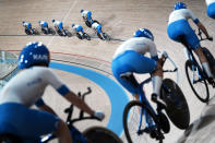 Members of the Italian women's and men's track cycling team round the track during a training session inside the Izu velodrome at the 2020 Summer Olympics, Thursday, July 29, 2021, in Tokyo, Japan. (AP Photo/Thibault Camus)