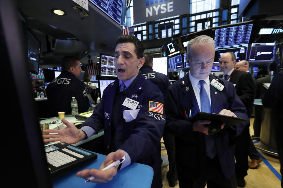 Specialist Peter Mazza, left, and trader James Riley work on the floor of the New York Stock Exchange. (Photo: AP Photo/Richard Drew)