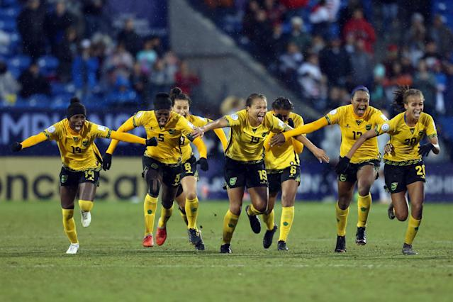Jamaica celebrate after beating Panama to reach their first Women's World Cup. (Photo by Omar Vega/Getty Images)