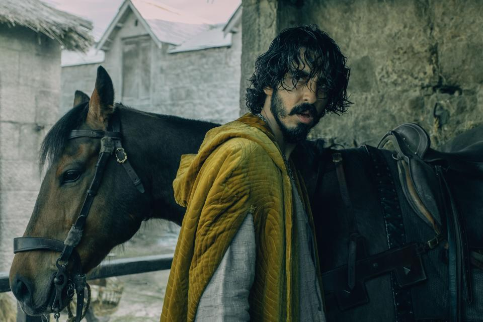 """This image released by A24 shows Dev Patel in a scene from """"The Green Knight"""". (A24 via AP)"""