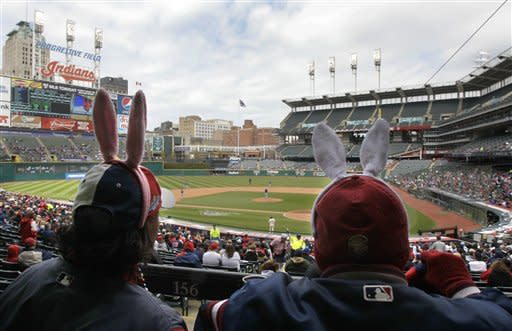 Fans wearing bunny ears watch as the Cleveland Indians take on the Toronto Blue Jays in a baseball game in Cleveland on Easter Sunday, April 8, 2012. (AP Photo/Amy Sancetta)