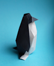 "<p>Use black and white paper to craft a sleek penguin. Create a whole colony to decorate a mantle, hang from the tree, serve as a table centerpiece, or dress up place settings.</p><p><em><a href=""http://howaboutorange.blogspot.com/2012/12/make-origami-penguin.html"" rel=""nofollow noopener"" target=""_blank"" data-ylk=""slk:See the idea at How About Orange»"" class=""link rapid-noclick-resp"">See the idea at How About Orange»</a></em><br></p>"