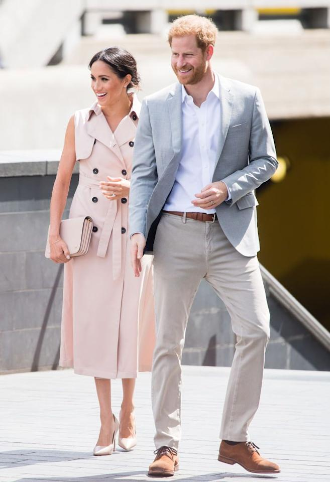 """<p>The royal couple shared a laugh <a rel=""""nofollow"""" href=""""https://www.townandcountrymag.com/style/fashion-trends/a22200767/meghan-markle-classic-trench-coat-nelson-mandela-exhibit/"""">while attending</a> the opening of a free exhibit about Mandela's life in South Africa and his fight against apartheid.</p>"""
