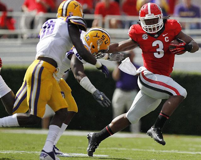 LSU linebacker Kwon Alexander, rear, and another defender pursue Georgia running back Todd Gurley (3) during the first half of an NCAA college football game, Saturday, Sept. 28, 2013, in Athens, Ga. (AP Photo/Mike Stewart)