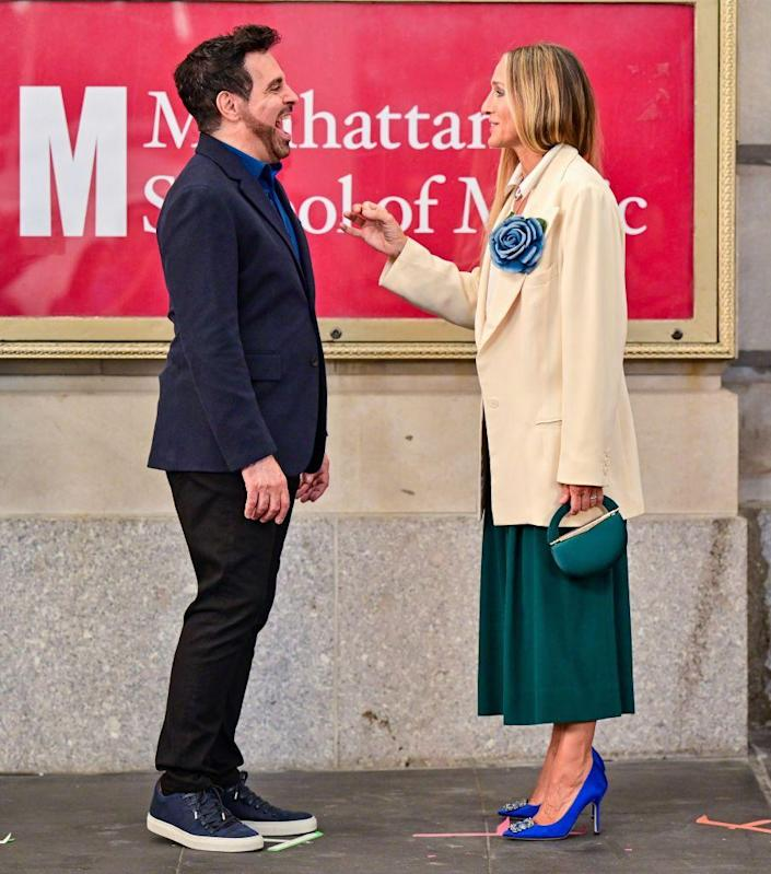 <p>Anthony Marentino's Mario Cantone shared a cute moment with Sarah Jessica Parker in a Paul Smith Soho blazer and John Varvatos Reed low-top sneakers. </p>