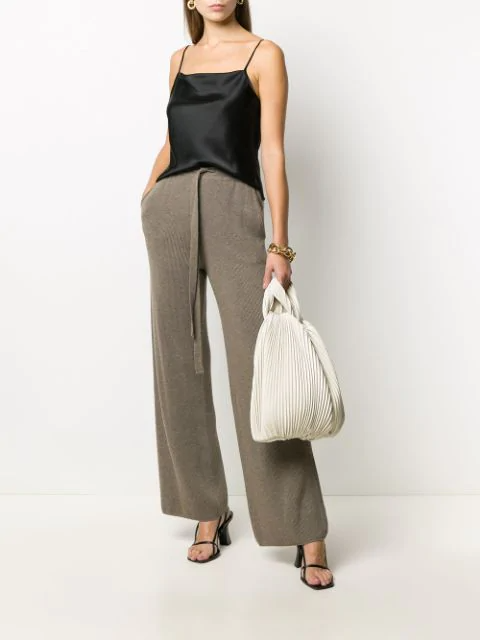 """<br><br><strong>Nanushka</strong> Ribbed-Knit Wool Trousers, $, available at <a href=""""https://go.skimresources.com/?id=30283X879131&url=https%3A%2F%2Fwww.farfetch.com%2Fshopping%2Fwomen%2Fnanushka-ribbed-knit-wool-trousers-item-15518326.aspx"""" rel=""""nofollow noopener"""" target=""""_blank"""" data-ylk=""""slk:Farfetch"""" class=""""link rapid-noclick-resp"""">Farfetch</a>"""