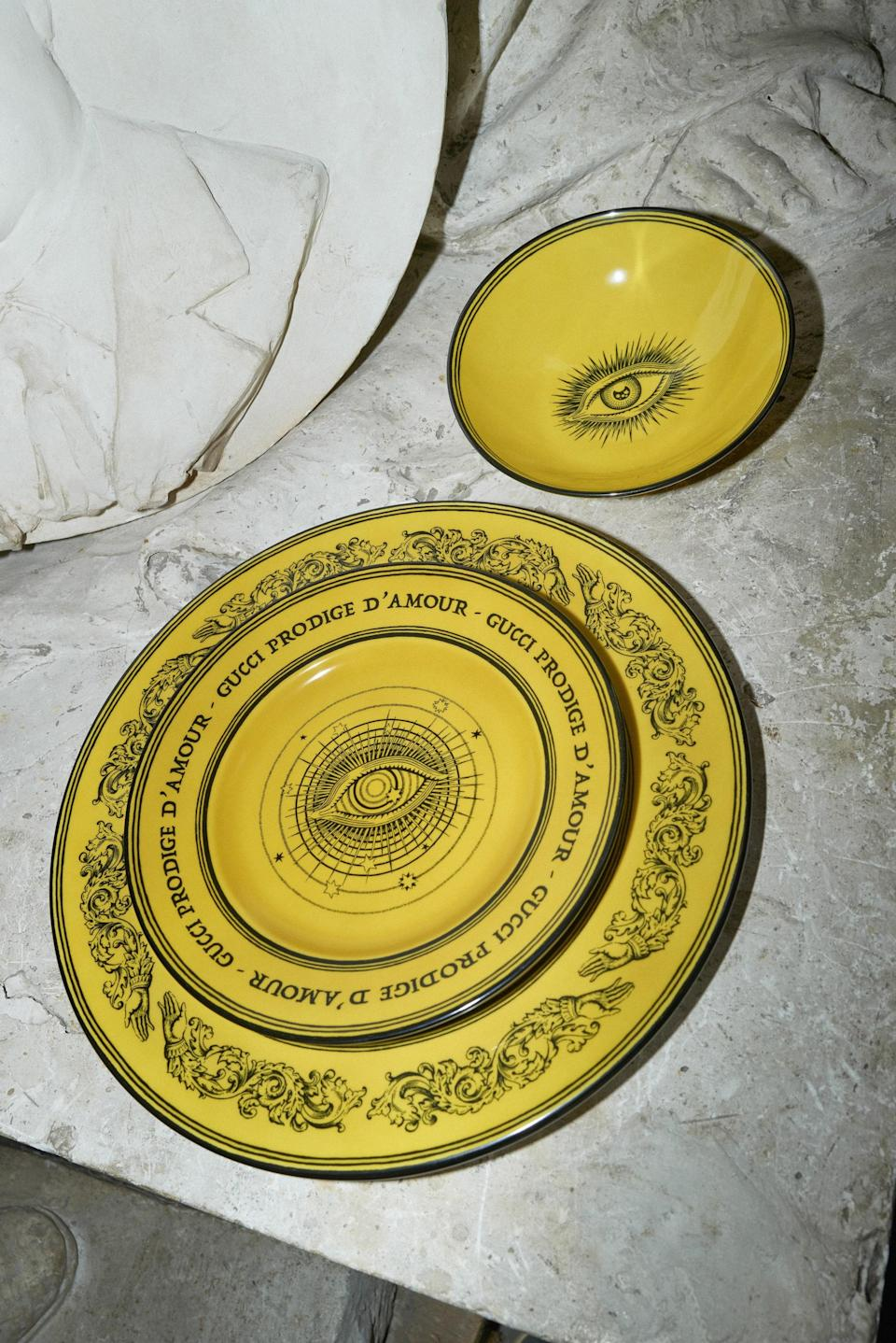 """Gucci plates, emblazoned with the House's """"Star Eye."""""""