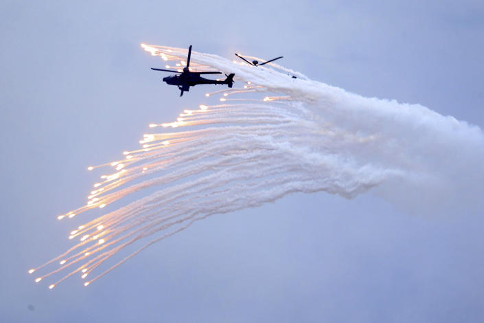 Taiwan's AH-64E Apache attack helicopter launches flares during the 36th Han Kung military exercises in Taichung City, central Taiwan, Thursday, July 16, 2020. (AP Photo/Chiang Ying-ying)
