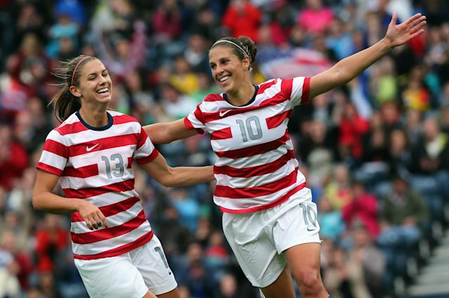 GLASGOW, SCOTLAND - JULY 28: Carli Lloyd of USA (R) celebrates with team-mate Alex Morgan after scoring their third goal during the Women's Football first round Group G match between United States and Colombia on Day 1 of the London 2012 Olympic Games at Hampden Park on July 28, 2012 in Glasgow, Scotland. (Photo by Stanley Chou/Getty Images)