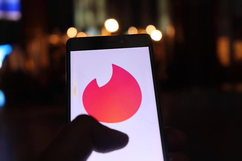 Tinder Logo can be seen on a Mobile Phone in New Delhi, India, on 26 July 2018. Tinder is a location-based social search mobile app that allows users to like or dislike other users, and allows users to chat if both parties swiped to the right. The app is often used as a hookup app (Photo by Nasir Kachroo/NurPhoto via Getty Images) (Photo: NurPhoto via Getty Images)