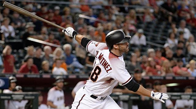 "<p>Free agent outfielder J.D. Martinez has reportedly reached an agreement with the Boston Red Sox on a deal worth $110 million over five years, <a href=""https://twitter.com/pedrogomezESPN/status/965711062212358144"" rel=""nofollow noopener"" target=""_blank"" data-ylk=""slk:according"" class=""link rapid-noclick-resp"">according</a> to to Pedro Gomez of ESPN and Jon Morosi of MLB Network.</p><p>Jon Heyman of FanRag Sports was the first to report that Martinez and the Red Sox were nearing a deal on Monday. Alex Speir of The Boston Globe <a href=""https://twitter.com/alexspeier/status/965712240308555777"" rel=""nofollow noopener"" target=""_blank"" data-ylk=""slk:reports"" class=""link rapid-noclick-resp"">reports</a> that the two sides are working around an agreement on a five-year deal. The deal includes an opt-out clause after two years, <a href=""https://twitter.com/jonmorosi/status/965714299028230150"" rel=""nofollow noopener"" target=""_blank"" data-ylk=""slk:according"" class=""link rapid-noclick-resp"">according</a> to Morosi and Gomez.</p><p>Martinez, 29, was one of the best hitters in the league last year as he recorded a .690 slugging percentage in 489 plate appearances between the Detroit Tigers and the Arizona Diamondbacks. He finished the season with a .303 batting average, 26 doubles, 45 home runs and a 1.066 OPS in 119 games on the year. He was dealt to Arizona before the July trade deadline and his numbers are more impressive when his 62 games in the National League show that he hit .302 with 29 home runs and 65 RBIs in the second half. In the past four years, Martinez is splitting .300/.362/.574. </p><p>During the Winter Meetings, his agent Scott Boras told teams that Martinez was seeking a contract in the $200 million range. That deal would still be a lot less than the $265 million that the New York Yankees will be shelling out for outfielder Giancarlo Stanton, who was acquired in a trade with the Miami Marlins before Christmas. The Stanton deal triggered major interest from the Red Sox to stay close on their American League East rivals and aggressively pursue Martinez. </p>"