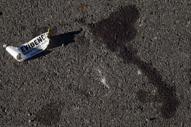 In this Oct. 5, 2012 photo, blood stains remain on the highway where protestors from the town of Totonicapan and soldiers clashed a day earlier on the outskirts of Santa Catarina Ixtahuacan, near Totonicapan, Guatemala. Experts said the arrest of soldiers in connection with the Oct. 4 killing of Indians protesting high electricity prices mark a dramatic shift in a country once known for its reluctance to punish its military. (AP Photo/Moises Castillo)