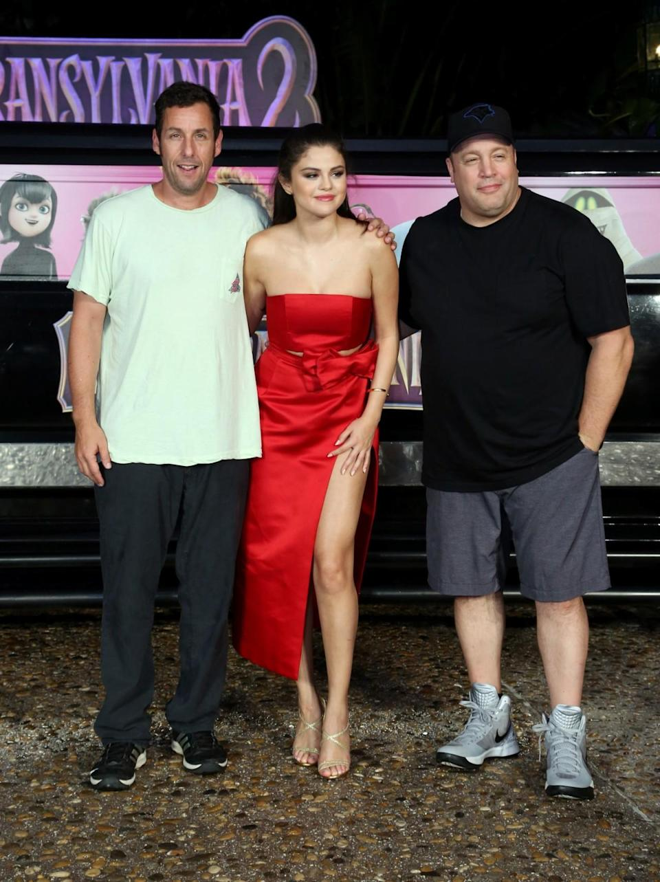 <p>Sandler, his buddy Kevin James (who is also a fan of comfy clothing), and Selena Gomez made quite a trio while promoting <i>Hotel Transylvania 2</i> in Cancun, Mexico, in 2015. Fortunately, Gomez was glam enough for all of them! (Photo: Victor Chavez/Getty Images)</p>