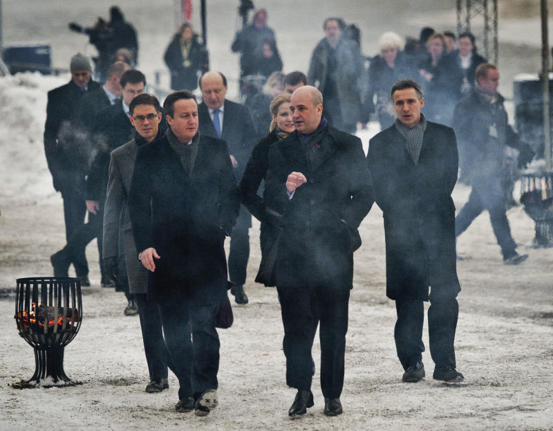 Britain's Prime Minister David Cameron, 2nd left, chats with Swedish Prime Minister Fredrik Reinfeldt, center, in front of  Finland's Prime Minister Jyrki Katainensom, left, and Norwegian Prime Minister Jens Stoltenberg, right, as they walk to the Photographic Museum in Stockholm, Sweden Thursday Feb. 9, 2012, to attend the Northern Future Forum, a gathering of leaders from Britain and the Nordic and Baltic countries. Sweden's Prime Minister Fredrik Reinfeldt says Europeans need to question their habits and give up prejudices if they are to secure the future of their generous pension systems.    (AP Photo/Jens L'Estrade/Scanpix Sweden)  SWEDEN OUT