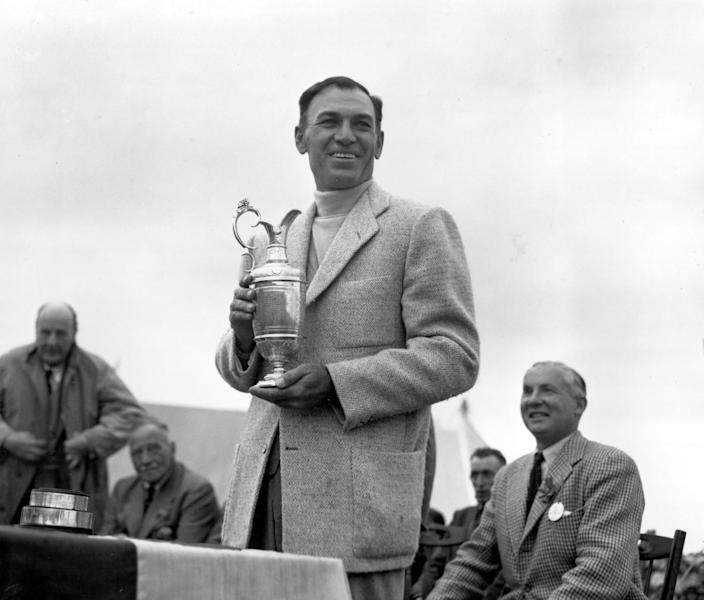 Ben Hogan holds his trophy after winning the British Open Golf Championship.