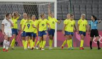 Sweden's Lina Hurtig (8) celebrates scoring her side's 3rd goal against United States during a women's soccer match at the 2020 Summer Olympics, Wednesday, July 21, 2021, in Tokyo. (AP Photo/Ricardo Mazalan)