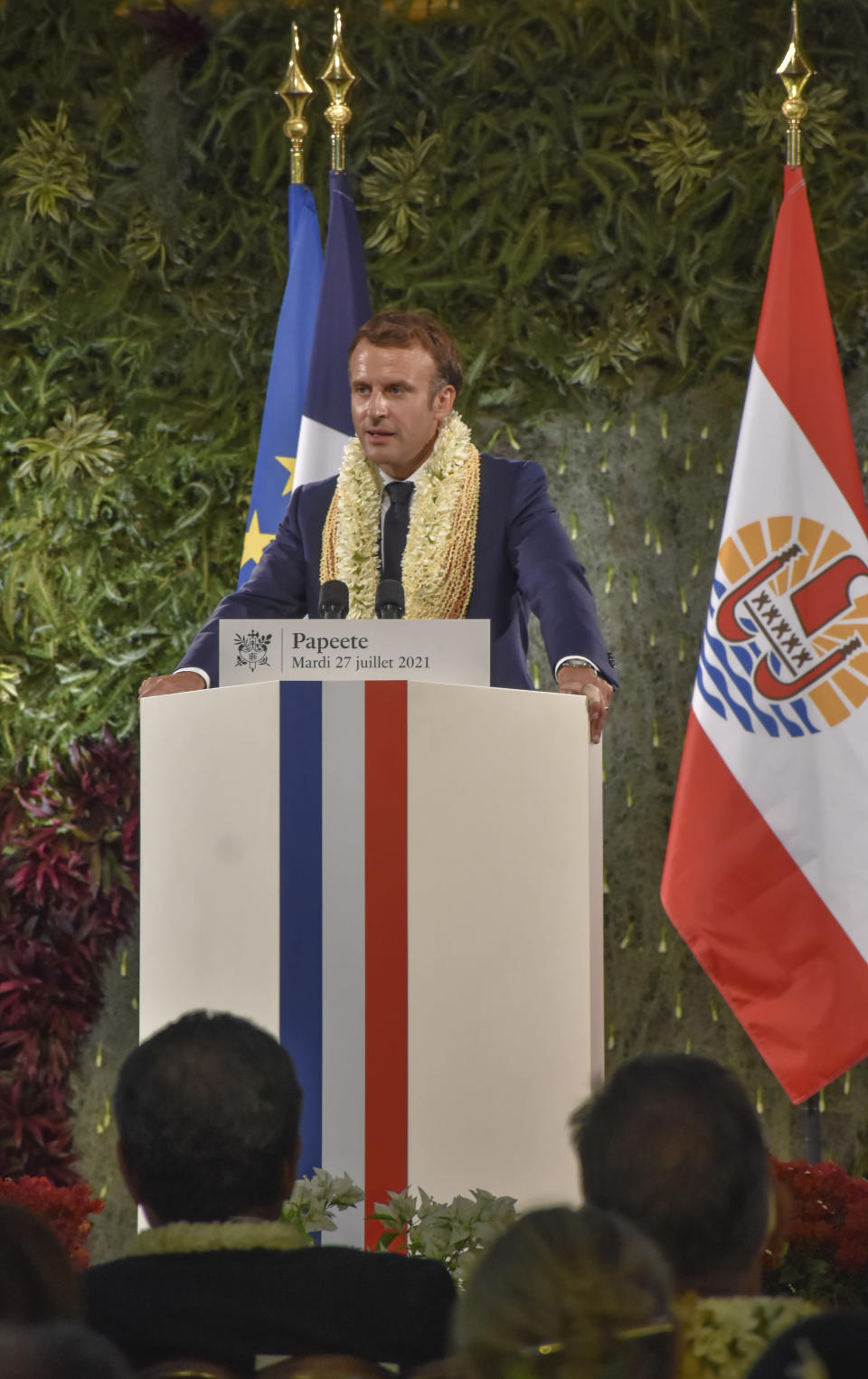 France's President Emmanuel Macron wearing a flower lei and seashell necklaces delivers a speech after a meeting with the President of the French Polynesia Edouard Fritch in Tahiti, French Polynesia in the Pacific Ocean, Tuesday, 27, 2021.President Emmanuel Macron reasserted France's presence in the Pacific on a visit to French Polynesia aimed in part at countering growing Chinese dominance in the region. (AP Photo/Esther Cuneo)