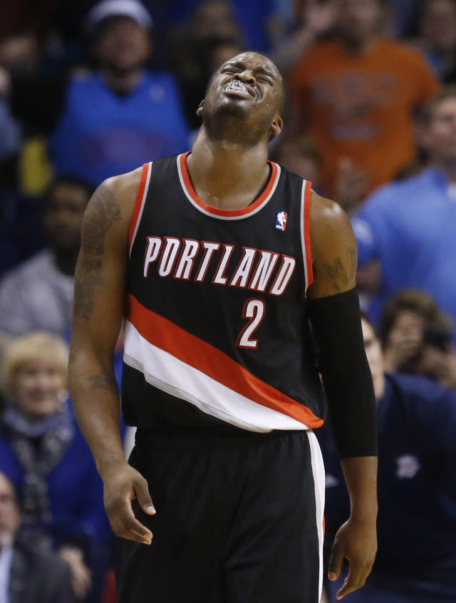 Portland Trail Blazers guard Wesley Matthews (2) grimaces after being fouled in the fourth quarter of an NBA basketball game against the Oklahoma City Thunder in Oklahoma City, Tuesday, Jan. 21, 2014. Oklahoma City won 105-97. (AP Photo/Sue Ogrocki)