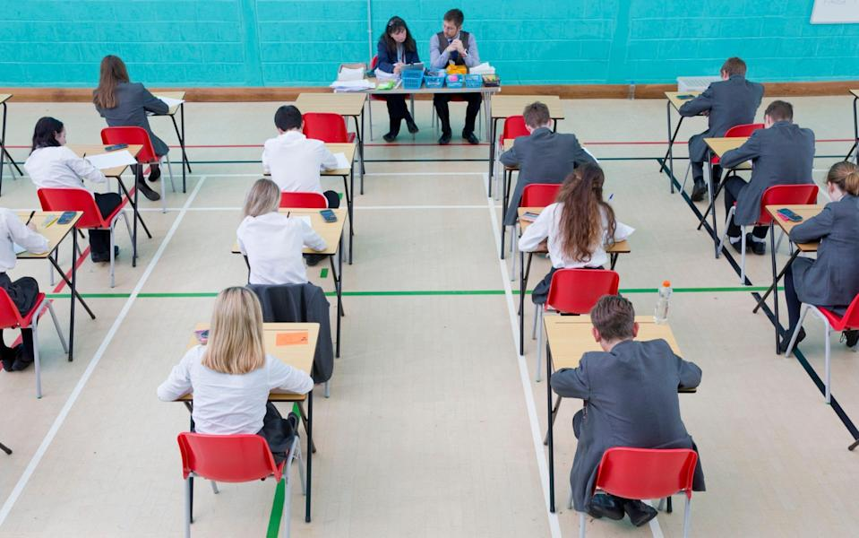 Pupils taking an exam - Juice Images