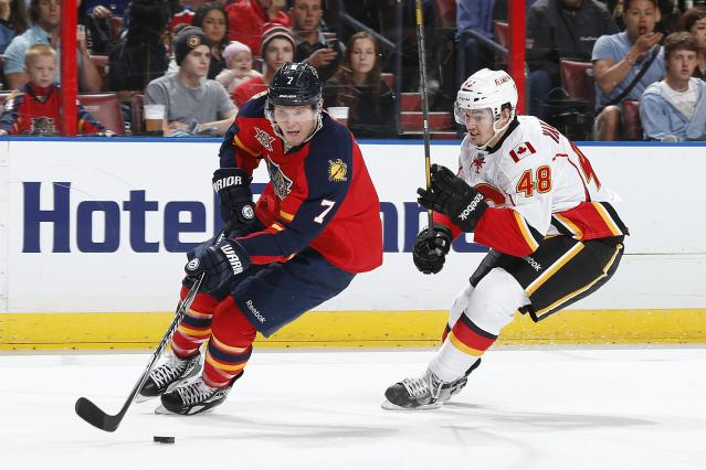 SUNRISE, FL - APRIL 4: Bryce Van Brabant #48 of the Calgary Flames pursues Dmitry Kulikov #7 of the Florida Panthers as he skates with the puck at the BB&T Center on April 4, 2014 in Sunrise, Florida. (Photo by Joel Auerbach/Getty Images)