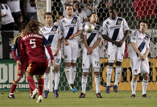 Los Angeles Galaxy defender Tommy Meyer, middle, blocks a free kick by Real Salt Lake midfielder Kyle Beckerman (5) during the second half of an MLS soccer match, Saturday, March 10, 2012, in Carson, Calif. Real Salt Lake won 3-1.(AP Photo/Bret Hartman)