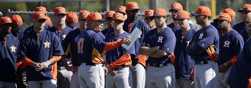 FILE - In this Feb. 16, 2013 file photo, Houston Astros third base coach Dave Trembley (47) talks to players before the start of a spring training baseball workout in Kissimmee, Fla. Alex Rodriguez will make more this year than all the Houston Astros combined _ a lot more. A-Rod's $29 million salary tops the major leagues for the 13th straight season, according to a study of major league contracts by The Associated Press. (AP Photo/David J. Phillip, File)