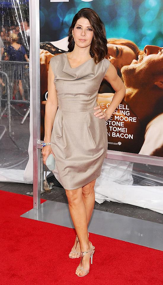 """Back in the States, fellow 40-something Marisa Tomei hit the red carpet for the premiere of her upcoming ensemble dramedy, """"Crazy, Stupid, Love.,"""" in a futuristic Vivienne Westwood cocktail frock, matching Sergio Rossi T-strap sandals, and azurite David Webb bracelet. Jamie McCarthy/<a href=""""http://www.wireimage.com"""" target=""""new"""">WireImage.com</a> - July 19, 2011"""