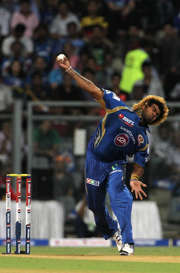 Mumbai Indian player Lasith Malinga bowls during match 10 of the Pepsi Indian Premier League ( IPL) 2013  between The Mumbai Indians and the Delhi Daredevils held at the Wankhede Stadium in Mumbai on the 9th April 2013 ..Photo by Vipin Pawar-IPL-SPORTZPICS ..Use of this image is subject to the terms and conditions as outlined by the BCCI. These terms can be found by following this link:..https://ec.yimg.com/ec?url=http%3a%2f%2fwww.sportzpics.co.za%2fimage%2fI0000SoRagM2cIEc&t=1506437857&sig=wfpvYYnqIB2j2s4M0cHOWw--~D