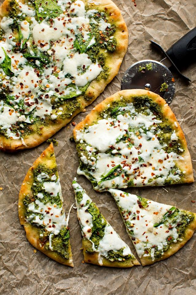 "<p>In a hurry? I like to use store-bought naan to make a super quick meal. Top with pesto and mozzarella with a little shake of red pepper flakes to heat things up!</p><section></section><p>Get the recipe from <a href=""/cooking/recipe-ideas/recipes/a53449/cheesy-spinach-pesto-flatbread-recipe/"" target=""_blank"">Delish</a>.</p>"