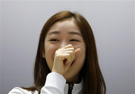 South Korean figure skater Kim Yuna smiles during a news conference ahead of Sochi 2014 Winter Olympics, in Seoul