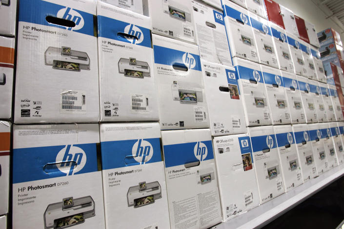 Boxes of Hewlett Packard printers are stacked up at a Best Buy store in Mountain View, Calif., Thursday, Nov. 15, 2007. Hewlett-Packard Co., the world's biggest PC seller, is scheduled to report fourth-quarter financial results after the market closes on Monday, Nov. 19, 2007. Wall Street is expecting another comfortably profitable quarter from the Palo Alto-based technology giant amid continued healthy demand for its crown jewel product _ lucrative printer ink _ and surging global PC sales, particularly for laptop computers.(AP Photo/Paul Sakuma)