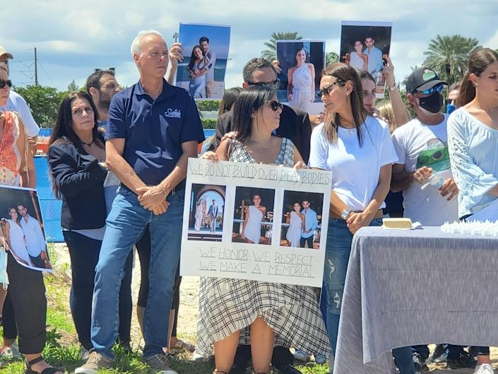 Families and friends of some of the 98 people killed in the collapse of Champlain Towers South in Surfside, Florida, hold a press conference calling for a memorial to be built at the site instead of selling to developers. Sept 23, 2021.