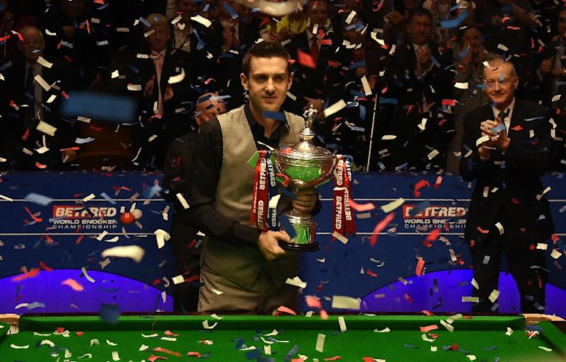 England's Mark Selby poses with the trophy after beating China's Ding Junhui in the final of the World Snooker Championship at the Crucible theatre in Sheffield, northern England, on May 2, 2016