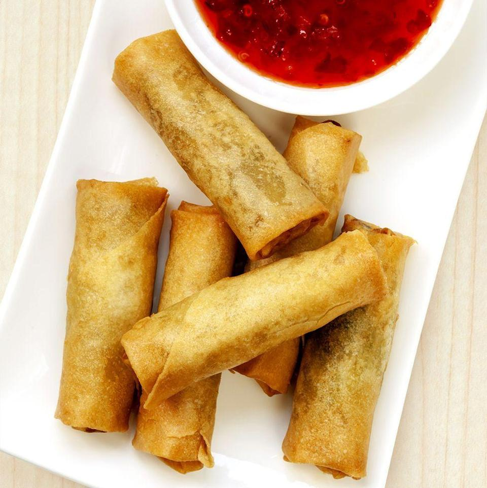 """<p>Full of delicious veggies like cabbage, mushrooms, and bamboo shoots, these spring rolls will be a hit at any party.</p><p><strong><em><a href=""""https://www.womansday.com/food-recipes/a35178656/veggie-spring-rolls-recipe/"""" rel=""""nofollow noopener"""" target=""""_blank"""" data-ylk=""""slk:Get the recipe for Veggie Spring Rolls."""" class=""""link rapid-noclick-resp"""">Get the recipe for Veggie Spring Rolls.</a></em></strong></p>"""