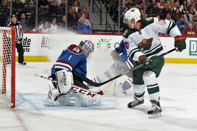 Colorado Avalanche goalie Semyon Varlamov (1) from Russia blocks a shot by Minnesota Wild center Torrey Mitchell (17) during the second period of an NHL hockey game Saturday, Nov. 30, 2013, in Denver. (AP Photo/Jack Dempsey)
