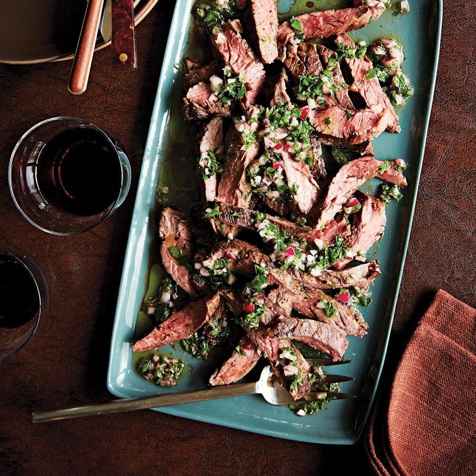 """<p>Traditionally used as fajita meat, skirt steak is gaining popularity these days as a stand-alone meat. It's my preferred cut of beef because it offers great flavor, tenderness, and affordability.</p> <p>I like to pan-sear this all-in-one cut over really high heat in my cast-iron skillet to create a nice char on the outside of the meat (open a window or turn on the fan in the kitchen). Instead of wasting time on a marinade, I prefer to reverse the process by slicing the meat thin and pouring all of the chimichurri sauce over the meat prior to serving. Trust me, it's a real showstopper when it comes to entertaining. Even better, this chimichurri sauce is super versatile. It also goes well on pork, chicken, and firm cuts of fish, such as shark and swordfish.</p> <p><a href=""""https://www.myrecipes.com/recipe/pan-seared-skirt-steak-chimichurri"""" rel=""""nofollow noopener"""" target=""""_blank"""" data-ylk=""""slk:Pan-Seared Skirt Steak + Chimichurri Recipe"""" class=""""link rapid-noclick-resp"""">Pan-Seared Skirt Steak + Chimichurri Recipe</a></p>"""