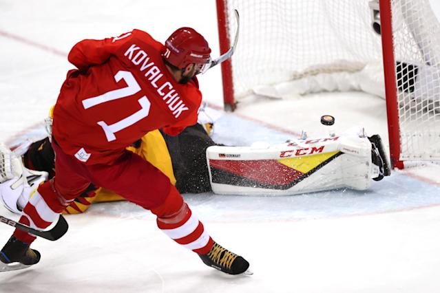 <p>Ilya Kovalchuk #71 of Olympic Athlete from Russia attempts a shot in overtime against Danny Aus Den Birken #33 of Germany during the Men's Gold Medal Game on day sixteen of the PyeongChang 2018 Winter Olympic Games at Gangneung Hockey Centre on February 25, 2018 in Gangneung, South Korea. (Photo by Ronald Martinez/Getty Images) </p>