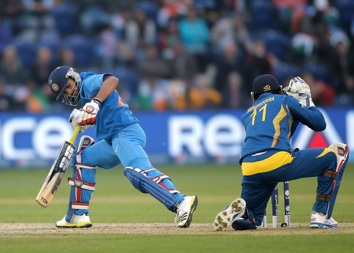 Shikhar Dhawan of India is stumped by Sri Lanka wicketkeeper Kumar Sangakkara during the ICC Champions Trophy Semi Final match between India and Sri Lanka at SWALEC Stadium on June 20, 2013 in Cardiff, Wales.  (Photo by Harry Engels-ICC/ICC via Getty Images)