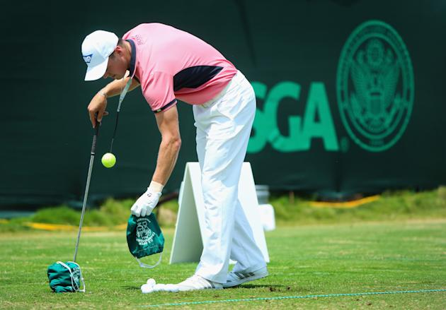 PINEHURST, NC - JUNE 14: Martin Kaymer of Germany works with a golf-training aid on the practice ground during the third round of the 114th U.S. Open at Pinehurst Resort & Country Club, Course No. 2 on June 14, 2014 in Pinehurst, North Carolina. (Photo by Andrew Redington/Getty Images)