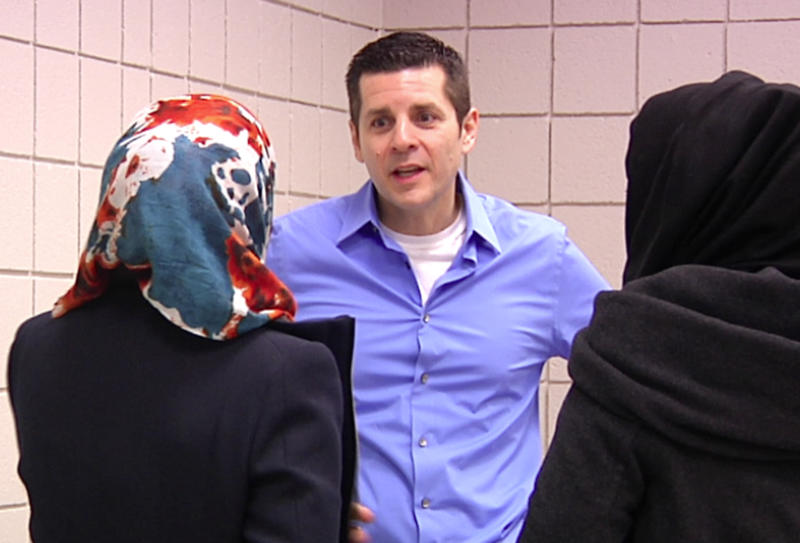In a frame grab from video shot on Feb. 24, 2012, muslim comedian Dean Obeidallah talks with students at Michigan State University in East Lansing, Mich. Arab-Muslim stand-up comedy is flourishing more than a decade after the terrorist attacks of Sept. 11. (AP Photo/Mike Householder)