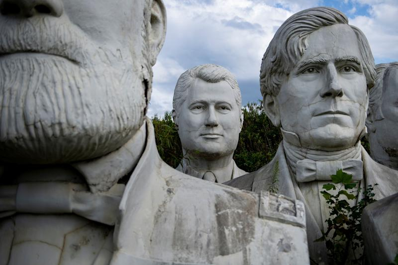 A bust of former US President Bill Clinton(C) can be seen among other busts of former US Presidents at a mulching business where they now reside August 25, 2019, in Williamsburg, Virginia.(Photo: Brendan Smialowski/AFP/Getty Images)