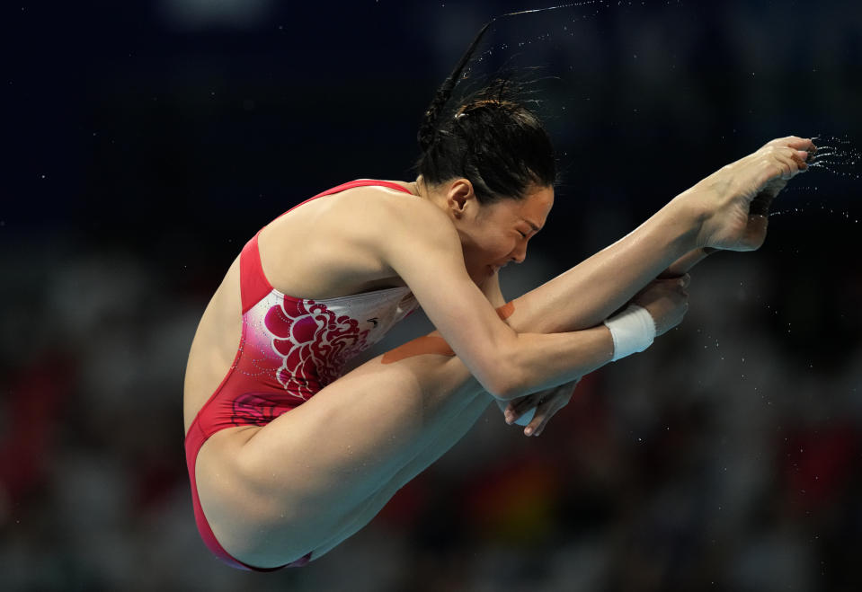 Wang Han of China competes in women's diving 3m springboard final at the Tokyo Aquatics Centre at the 2020 Summer Olympics, Sunday, Aug. 1, 2021, in Tokyo, Japan. (AP Photo/Dmitri Lovetsky)