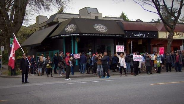 Dozens of people attended the protest in Vancouver's Kitsilano neighbourhood Friday night.