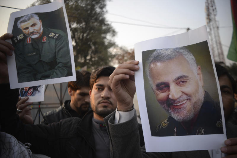 "Pakistani demonstrate over the U.S. airstrike in Iraq that killed Iranian Revolutionary Guard Gen. Qassem Soleimani, in Peshawar, Pakistan, Friday, Jan. 3, 2020. Iran has vowed ""harsh retaliation"" for the U.S. airstrike near Baghdad's airport that killed Tehran's top general and the architect of its interventions across the Middle East, as tensions soared in the wake of the targeted killing. (AP Photo/Muhammad Sajjad)"