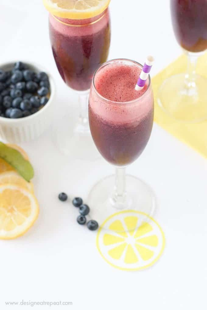 """<p>This light and refreshing drink couldn't be easier to make—simply toss everything into the blender, strain, and pour over ice. </p><p>Get the recipe at <a href=""""https://www.designeatrepeat.com/blueberry-lemon-moscato-spritzers/"""" rel=""""nofollow noopener"""" target=""""_blank"""" data-ylk=""""slk:Design Eat Repeat"""" class=""""link rapid-noclick-resp"""">Design Eat Repeat</a>. </p>"""