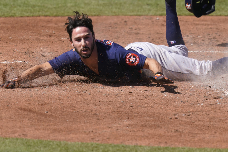 Houston Astros' Garrett Stubbs scores of a double hit by Abraham Toro during the fifth inning of a spring training baseball game against the St. Louis Cardinals, Sunday, March 7, 2021, in Jupiter, Fla. (AP Photo/Lynne Sladky)