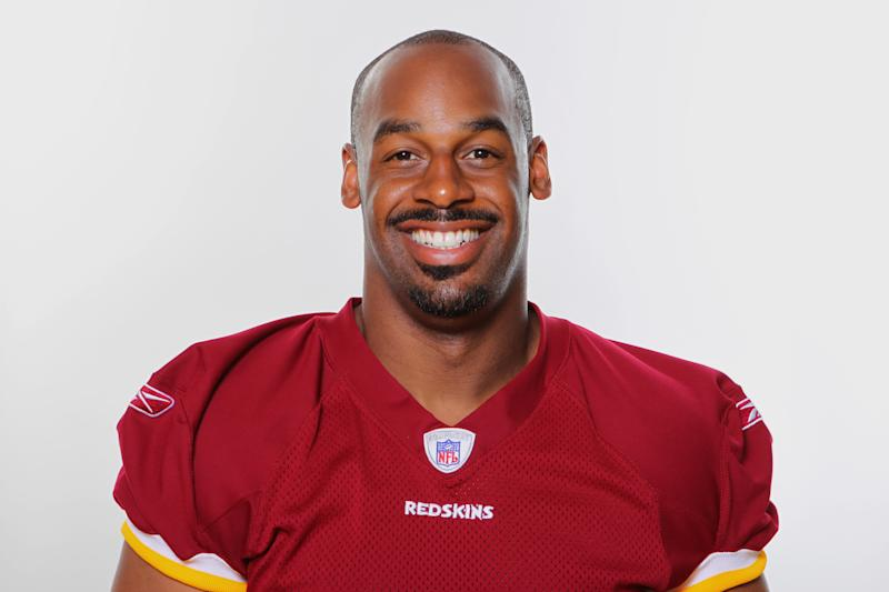 File - This is a 2010 file photo of Donovan McNabb of the Washington Redskins NFL football team. The Vikings acquired McNabb Wednesday July 27, 2011 from Washington for a sixth-round draft pick in 2012 and a conditional sixth-rounder in 2013, two people with knowledge of the transaction told The Associated Press. McNabb has yet to officially sign his restructured contract.  (AP Photo, File)
