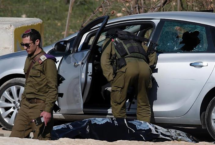 A Palestinian man tried to ram his car into military bases before being shot dead by Israeli forces on December 11, 2015 (AFP Photo/Thomas Coex)