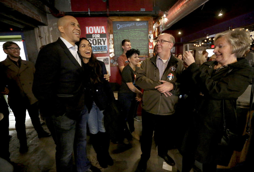 Democratic presidential candidate Sen. Cory Booker, D-N.J., and actress Rosario Dawson embrace before an event at Smokestack in Dubuque, Iowa, on Sunday, Dec. 8, 2019. (Jessica Reilly/Telegraph Herald via AP)